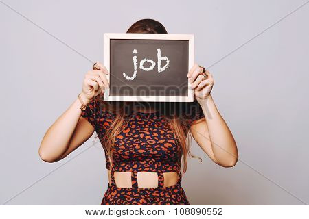 Young Woman Holding A Chalkboard Saying Job