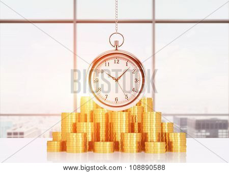 A Composition Of Golden Coins And Hanging On The Chain Pocket Watch. Sunset New York Panoramic View.