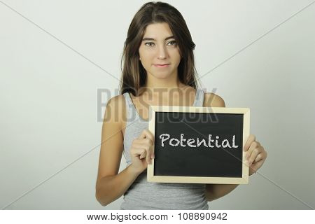 Young Woman Holding A Chalkboard Saying Potential.