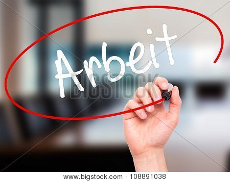 Man Hand writing Arbeit (Work in German) with black marker on visual screen.