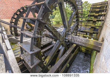 Three Water Wheels At A Watermill