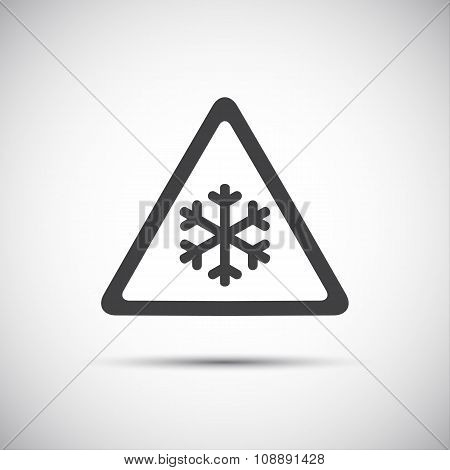 Triangular warning symbol with snowflakes