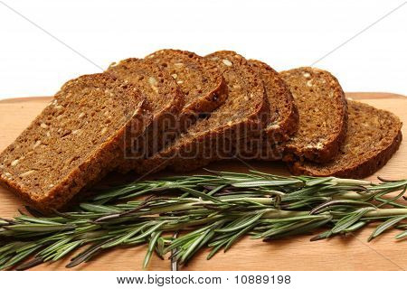 Cut Bread, Rosemarine And Wooden Board Isolated On A White Backgroud
