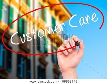Man Hand writing Customer Care with black marker on visual screen.