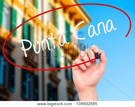 Man Hand writing Punta Cana with black marker on visual screen