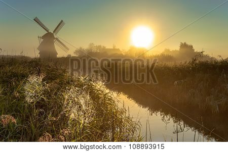 Windmill In Marshland With Cobwebs