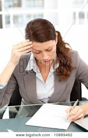 Worried Businesswoman Working At A Table