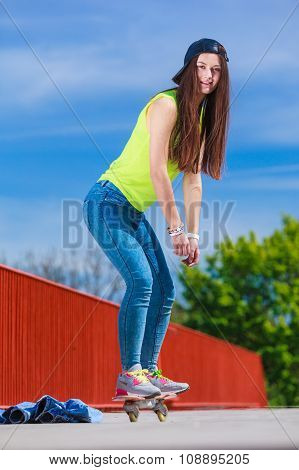 Teen Girl Skater Riding Skateboard On Street.
