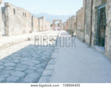 Defocused Background Of Archaeological Ruins In Pompeii