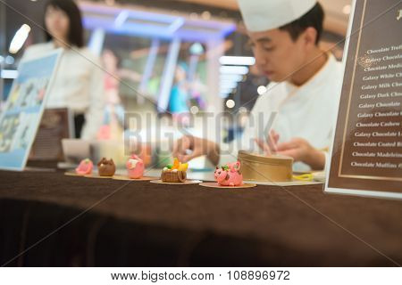 Macao, China - June 25, 2015:master Making Cartoon Characters By Chocolate In A Hotel In New Sands M