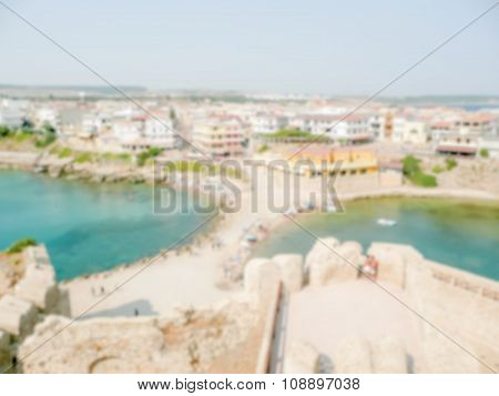 Defocused Background Of Le Castella Town In Calabria, Italy