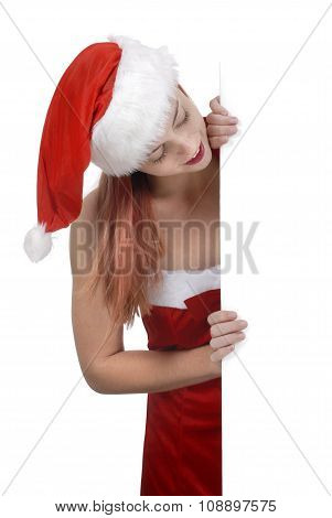 Smiling Young Adult Woman In Santa Hat Holding Plain White Blank Billboard Or Sign, Shopping Retail