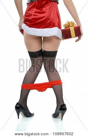 Female Santa Party Girl With Panties Falling Down Accident And Red Gift Box Isolated On White Backgr