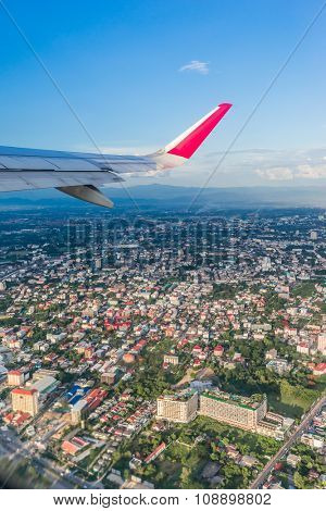 the airplane is taking off over Chiang mai city