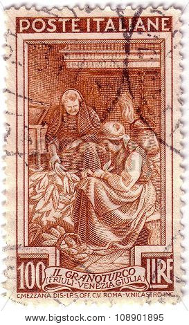 Italy - Circa 1950: A Stamp Printed In Italy, Shows Woman Purified Corn Cobs, Series Work Of Italian