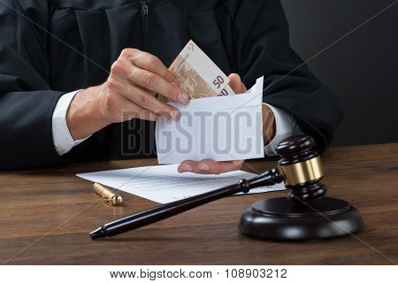 Judge Removing Money From Envelope