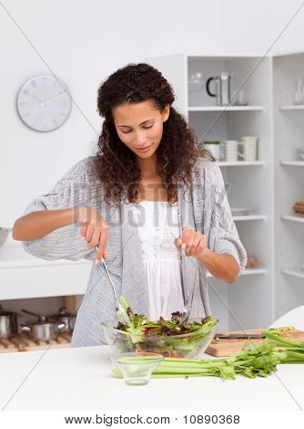 Cute Hispanic Woman Preparing Her Lunch In The Kitchen