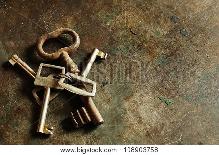 old keys on metal texture.