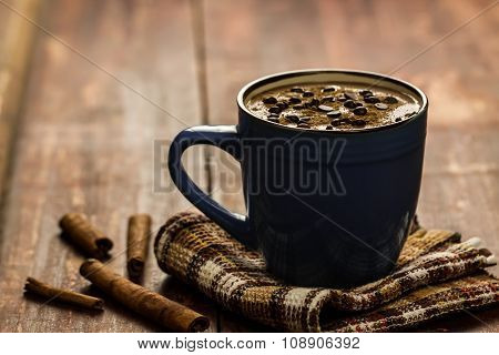 Cup Of Hot Chocolate With Cinnamon On Wooden Background