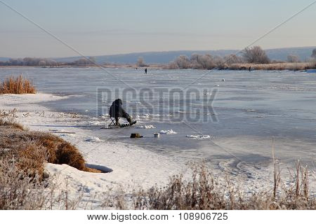 Fishermen On The Snow-covered Lake.