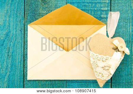 Vintage Old Envelope With Heart On A Blue Wooden Background