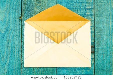 Vintage Old Envelope On A Blue Wooden Background