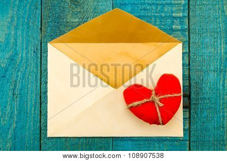 Vintage Old Envelope With A Red Heart On A Blue Wooden Background