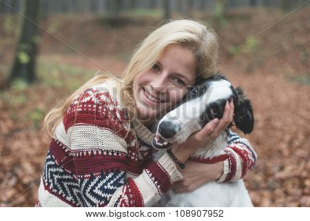 Young blonde woman embraced her cute Borzoi dog outdoor