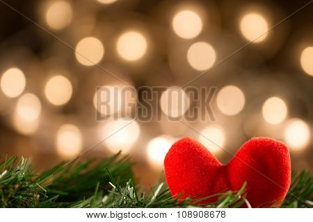 Red Heart On Yellow Background Defocused Lights. Festive Decoration. Christmas