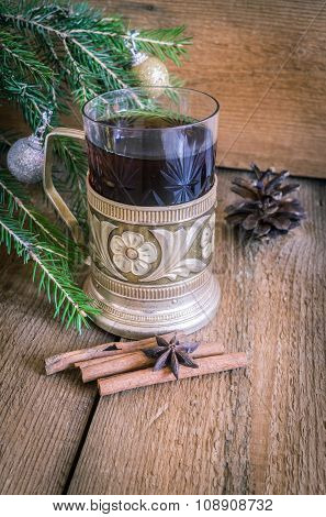 Christmas and new year decoration, tea in glass with coaster