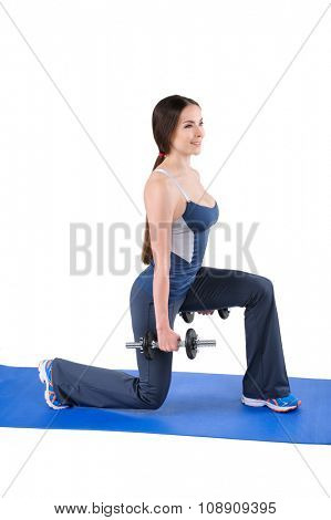 Young woman shows finishing position of Dumbbell Split-Squat workout, isolated on white