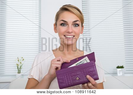 Happy Woman Showing Money In Purse