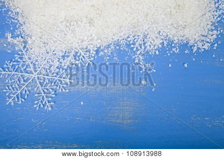 Snowflakes And Snow On A Blue Background