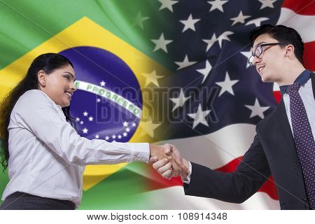 Brazilian Woman Shaking Hands With American Person