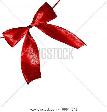 Chrismas gift Vibrant red color holiday satin bow on white background