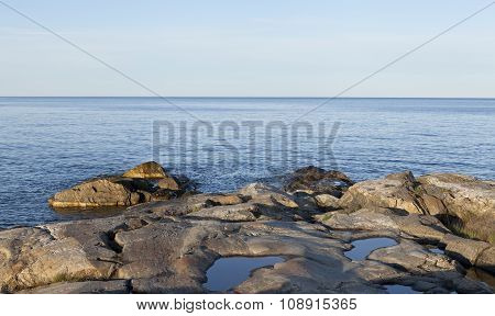 Shore, rocks and cliffs by the seaside.