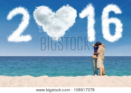 Couple Kissing At Beach With Numbers 2016