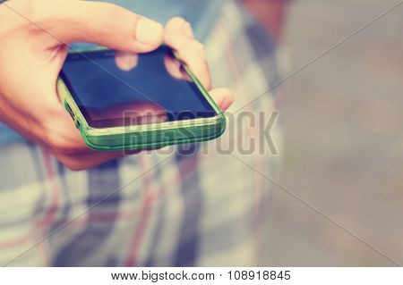 Typing messages on a smart-phone. Shallow depth of field.