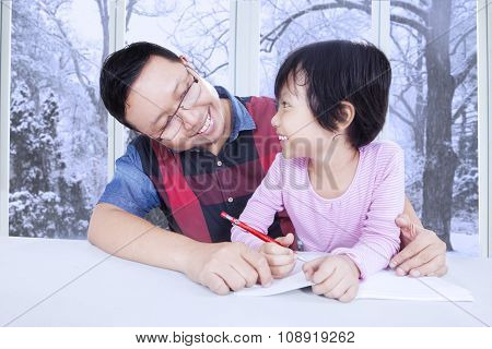 Cute Girl Studying With Her Dad At Home