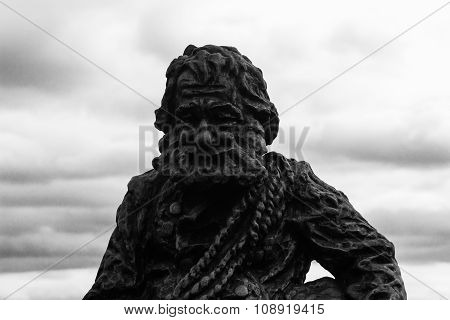 Lviv, Ukraine - November 15, 2015: Sculpture A Chimney Sweep On The Roof Of The House Of Legends On
