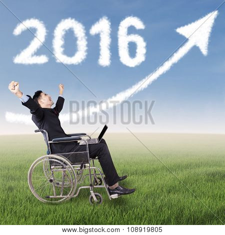 Disabled Businessman With Numbers 2016 And Arrow