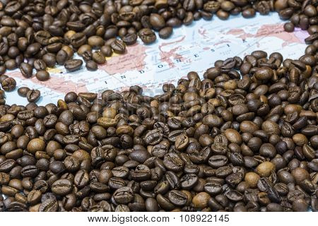 Map Of Indonesia Under A Background Of Coffee Beans