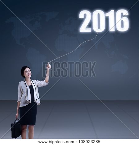 Female Worker Pulling Down Number 2016