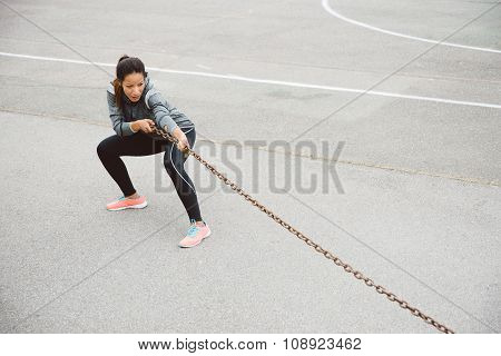 Fitness Woman Pulling Chain For Strength Workout