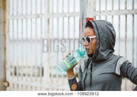 Urban Fitness Woman Drinking Water On Workout Rest