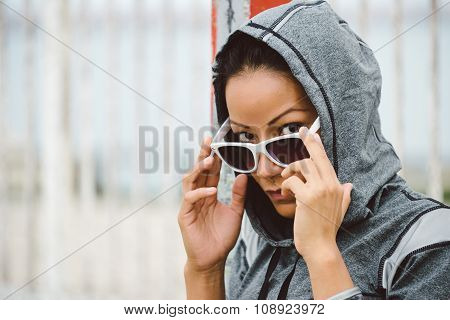 Tough Looking Urban Fitness Woman With Sunglasses