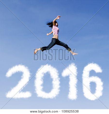Joyful Woman Leaps Above Numbers 2016
