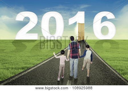 Kids And Father Walking Toward Numbers 2016