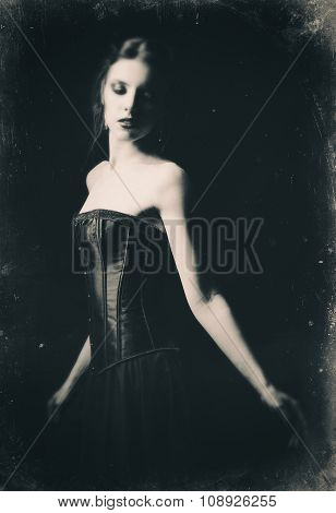 Dramatic Retro Portrait Of Beautiful Sad Gothic Girl Among The Dark. Old Film Effect, Black And Whit
