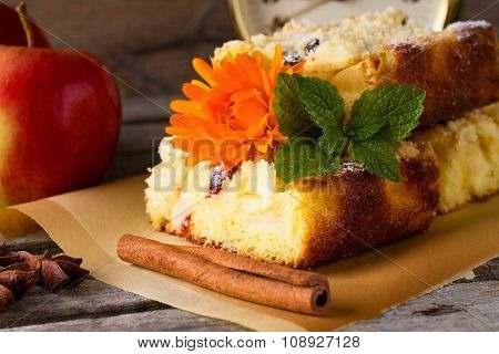 Cinnamon In Front Of Apple Cake
